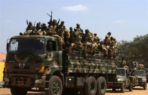SPLA soldiers drive in a truck in Juba