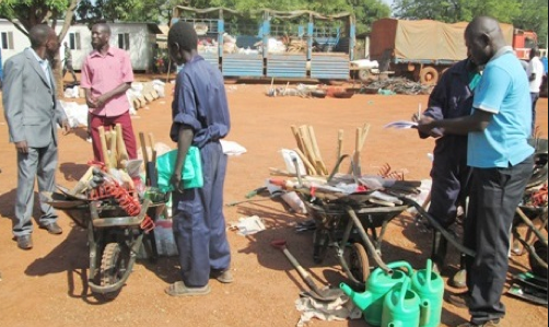 Ex-combatantsdistributing business tool-kits to 92 ex-combatants who graduated in Mapel town receiving agricultural tool-kits in Wau. [James Deng Dimo]