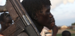 FILE - A man from the Luo Nuer tribe carries his gun in Yuai Uror county, South Sudan (Photo: VOA)