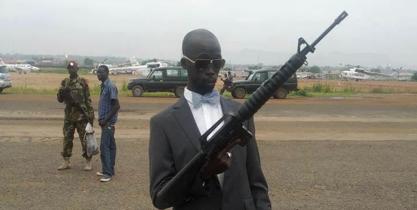 Mabior Garang de Mabior holding a rifle(photo:supplied)