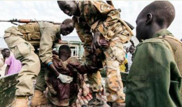 An SPLA soldier, shot in Malakal clusters earlier this year, dragged by his colleagues to safety.(Photo: past files)