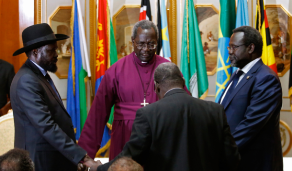 The Episcopal Archbishop of Sudan, Daniel Deng Bul, prayed and presided over the first face-to-face meeting in Addis Ababa 9 May between Salva Kiir Mayardiit, left, and Dr. Riek Machar Teny, the warring factions leaders (Photo: Goran Tomasevic/Reuters)