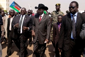 President Salva Kiir Mayardit, centre, with Vice President Dr. Riek Machar, left, and James Wani Igga, centre right, Speaker of the Legislative Assembly, at Juba airport on 8 February 2011