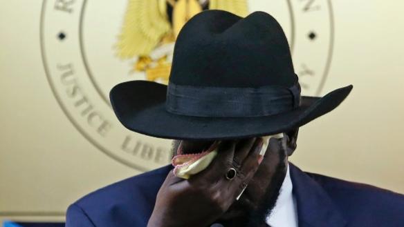President Salva Kiir wipes his face with a pink handkerchief(Photo: via UAH-Uganda)