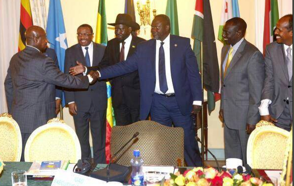 Ugandan President, Yoweri Museveni, greets Dr. Riek Machar of SPLM/SPLA after negotiating the withdrawal of his troops in South Sudan(Photo: supplied)