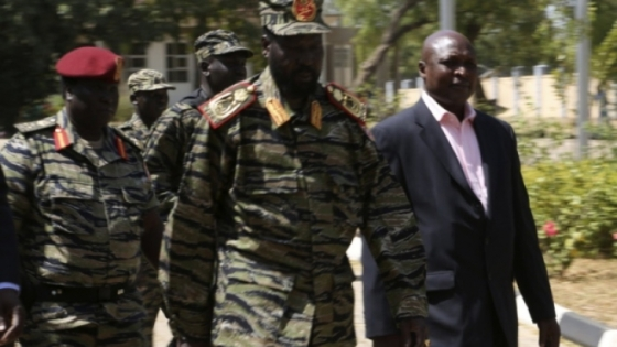 Gen. Salva Kiir Mayardiit wearing military uniforms afte announcing that he just foiled a coup. Four months later the coup allegation flatered and the politicians arrested were all released due to lack of evidence. The coup campaign died down until last week when Jok Madut ignited it although he lacks evidence(Photo: TVC)