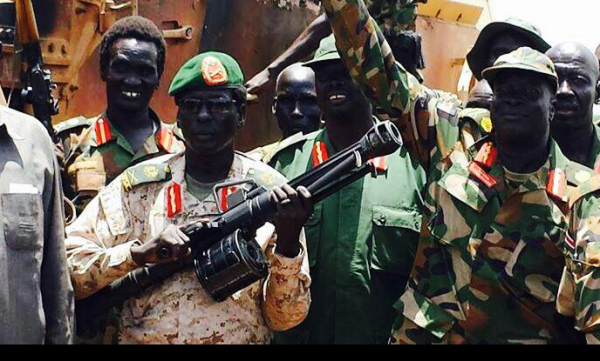 The Military Governor of Unity State, Peter Gatdet Yak and his counterpart, Maj. Gen. James Koang Chuol showing off their weapons after defeating government forces in Unity state(Photo: supplied)