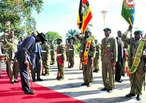 Salva Kiir bowing to Ugandan army as he access the UPDF before their military intervention in South Sudan's man-made crisis. fter 70% of South Sudan army defected Salva Kiir's leadership depends on Ugandan army and other foreign factors from the region (Photo: supplied)