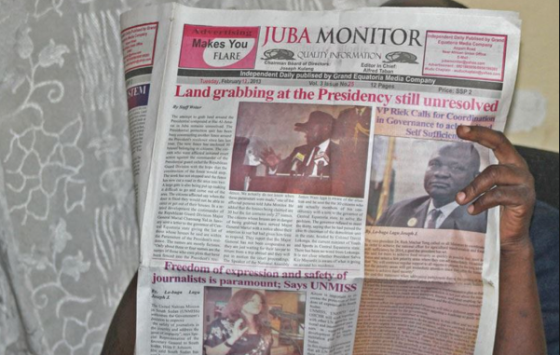 A person reads the Juba Monitor on the day the paper ran the story about the U.N. Mission in South Sudan's (UNMISS) Plan of Action on the Safety of Journalists. South Sudan has agreed to test drive the plan, which calls for defamation to be decriminalized(Photo: via VOA)