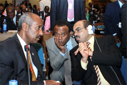 Seyoum Mesfin (left) and TPLF puppet Tekeda Alemu (center) with Meles Zenawi Posted by Tekeda Alemu