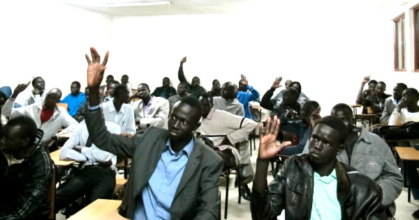 South Sudan Nuer community meeting in Ethiopia raising hands to speak during the meeting(Photo: supplied)