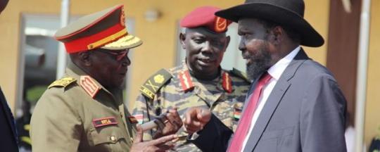 South Sudan President Kiir Mayardiit chats with Paul Malong, the former governor of Northern Bahr el Ghazal, at Juba airport(Photo: via Radio Tamazuj)