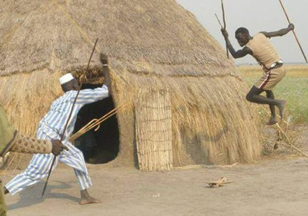 Nuer warriors demonstrating a cultural practice, aimed to highlight how men could tactically fight off a sudden attack by spears, in a close range (Photo: Nyamilepedia)