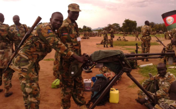 The fierce fighter, Elbow Chuol on multiple machines guns during preparation for SPLM/SPLA Conference in Pagak, 2014(Photo: Elbow Chuol/Nyamilepedia)