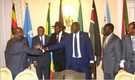 Ugandan President, Yoweri Museveni, greets Dr. Riek Machar of SPLA after negotiating the withdrawal of his troops in South Sudan(Photo: Nyamilepedia)