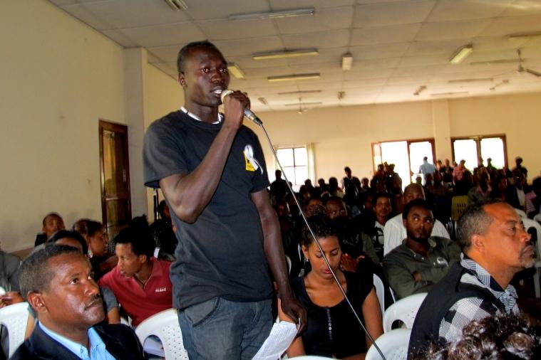 Peace Ambassador Gatwech addresses the crowd at Gender Violence