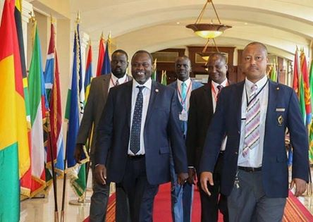 SPLM-IO's Dr. Riek Machar, Chief Negotiator Hon. Taban Deng Gai, Youth League Chairman Cde. Puot Kang Chol and Cde. Kou being led in by IGAD protocol service personel