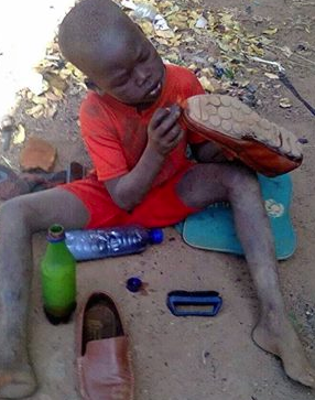 A shoe-less child repairing a shoe of an adult in South Sudan capital, Juba(Photo: supplied)