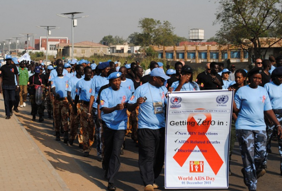 Secondary Roles UNMISS staff members marching during the 2011 World AIDS Day celebrations jointly with organized forces of ...