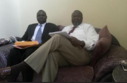 Charles Pioneson SPLM/SPLA, Deputy Representative to Canada SPLM/SPLA Canada, sitting with Dr. Riek Machar in Addis Ababa, Ethiopia(Photo: Charles/Nyamilepedia)