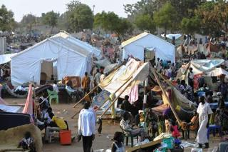 People gather at a makeshift IDP camp at the UN compound in Juba at the beginning of the conflict(photo: file)