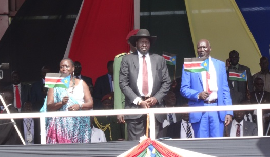 South Sudan's Salva Kiir with Dr. Anne Itto, the SPLM acting Secretary General on the stage to address a rally in Juba, South Sudan, August 18, 2015(Photo: file)