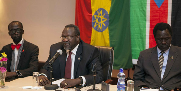 Riek Machar (centre),  at a press conference at the Radisson Hotel in Addis Ababa, Ethiopia, on July 9, 2014. He is flanked by Ezekiel Lol Gatkuoth (right), and De-Mabior Garang. Igad has warned Machar team of sanctions for skipping peace talks. AFP PHOTO   ZACHARIAS ABUBEKER