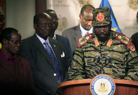 South Sudan's President Salva Kiir (R) addresses a news conference at the Presidential Palace in capital Juba December 16, 2013.
