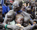 A South Sudanese man protecting his children from an internal conflict(Photo: file)