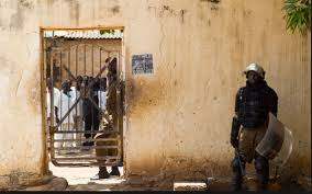 A Prison Warden standing at the gate of Torit, Eastern Equatoria Prison. (Photo/Nyamilepedia)