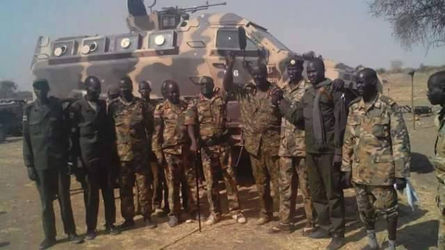 SPLA-IO Generals posting for a picture near their newly captured mounted truck in Wedakona(Photo: file)