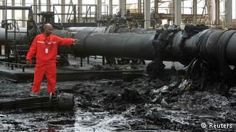 An engineer points at the damage to an oil pipeline in a largely damaged oilfield in Heglig over which South-North Sudan blames one another for(Photo credits: Reuters)