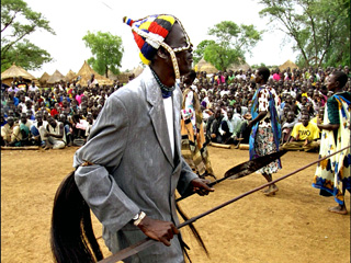 Anyuak King, his Majesty Adongo Agada Akway Cham Gilo dancing during traditional Anyuak crowning of a king ceremony in 2001(Photo: Anyuak Media)