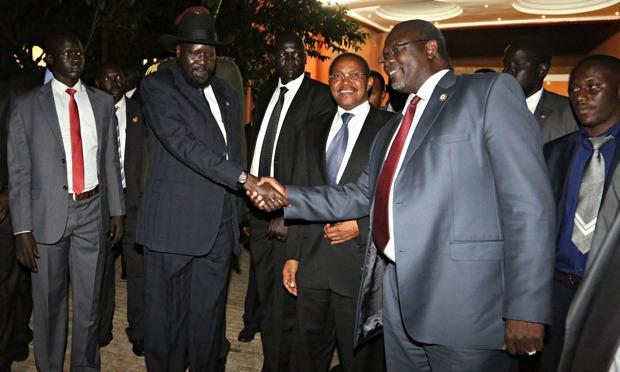 President Salva Kiir and Dr. Riek Machar greet after a peace talk in Arusha, Tanzania.(Photo credits: Muhidin Michuzi )