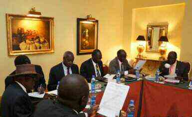 Negotiators at South Sudan peace talks in the Ethiopian capital, Addis Ababa, review a draft cessation of hostilities agreement on 13 January 2014 (Photo: courtesy of Larco Lomayat)