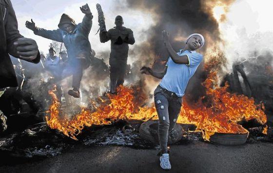 xenophobia-in-south-africa By Umar Muhammad Puma & Lawrence Olaoye