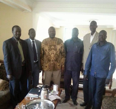 Gatluke Reat (far left) posts for a picture with SPLM/SPLA Chairman, Dr. Riek Machar Teny, in Addis Ababa, Ethiopia(Photo: supplied/Nyamilepedia)