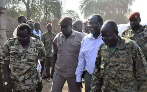 Dr. Riek Machar Teny taking a walk with his deputy Alfred Lado Gore and Gen. Gathoth Gatkuoth in Pagak, South Sudan(Photo: Profiles)