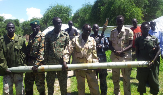 South Sudan ANTI-government forces posting with a huge missile they captured from the government forces in Panyinjiar County, Unity State(Photo: Via Abraham Majak)