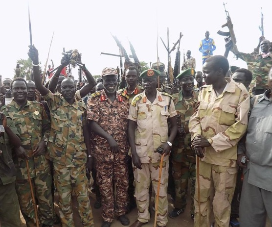 SPLA Opposition fighters in Lakes State lead by former SSTV director Gen. Abdellatif Chuwoul pose in front of Cameras after capture of a town in the region.