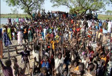 People of Old Fangak welcoming building supplies from USA for Sudan Project(Photo: Sudanmedicalrelief.org)