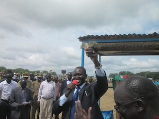 Bor town mayor, Nhial Majak, showing the money collected for development projects in the Jonglei capital, June 29, 2013..
