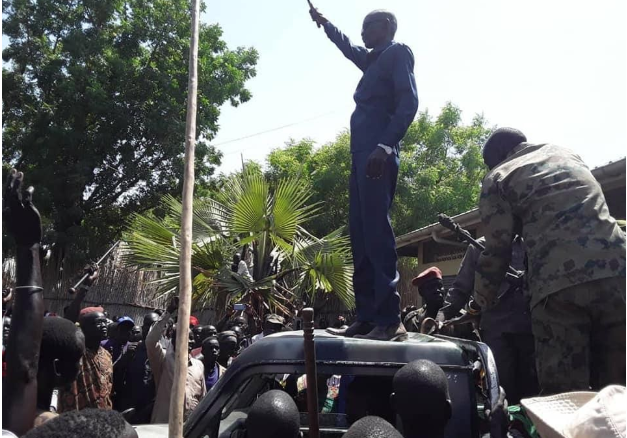 Panyijiar county commissioner, Yohannes Kujiek Ruot Loge waving to the crowd on top of vehicle in Ganyliel Town in 2019(Photo credit: supplied by author)