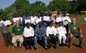 Members of South Sudan traffic police who participated in a training session posts for a picture with their trainer, Wau South Sudan(Photo credit: James Deng Dimo/Nyamilepedia)